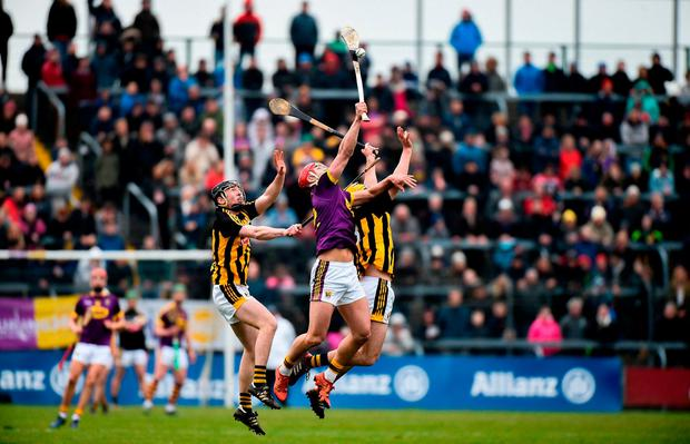 Wexford's Lee Chin goes up against Conor Delaney and Richie Leahy of Kilkenny. Photo: Matt Browne/Sportsfile