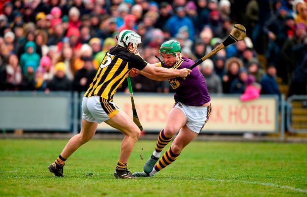 Wexford's Conor McDonald and Padraig Walsh of Kilkenny tussle for possession. Photo: Matt Browne/Sportsfile