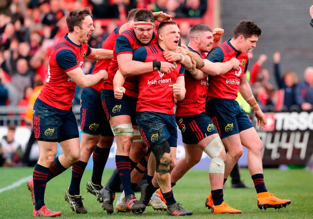 Andrew Conway is mobbed by his Munster team-mates after scoring the late try to edge his team ahead of Toulon at Thomond Park on Saturday. Photo: David Rogers/Getty Images