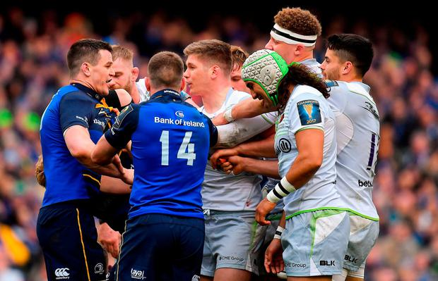 Owen Farrell, centre, confronts Johnny Sexton during their Champions Cup quarter-final clash at the Aviva. Photo: Brendan Moran/Sportsfile