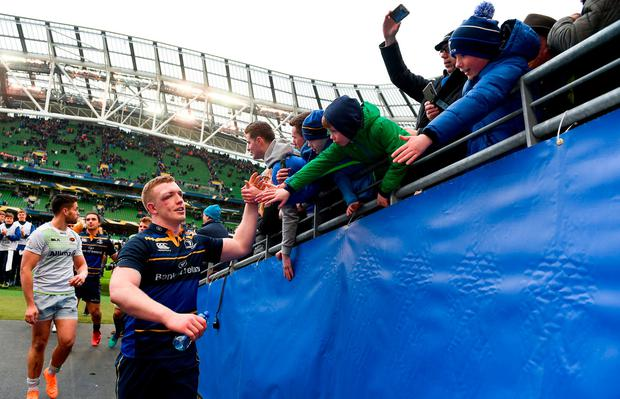 Dan Leavy celebrates with Leinster fans at the end of the game. Photo: Ramsey Cardy/Sportsfile