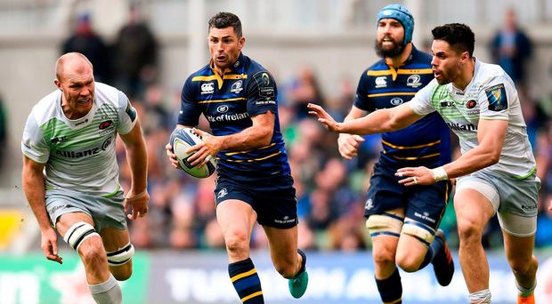 Rob Kearney makes a break for Leinster, hotly pursued by Saracens duo, Schalk Burger and Sean Maitland. Photo: Ramsey Cardy/Sportsfile