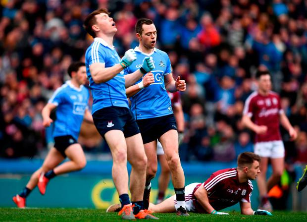 Dean Rock, right, and teammate Con O'Callaghan react to a missed opportunity. Photo: Stephen McCarthy/Sportsfile