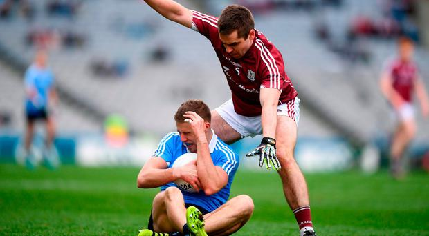 Dublin's Paul Mannion hits the ground under pressure from Cathal Sweeney. Photo: Stephen McCarthy/Sportsfile