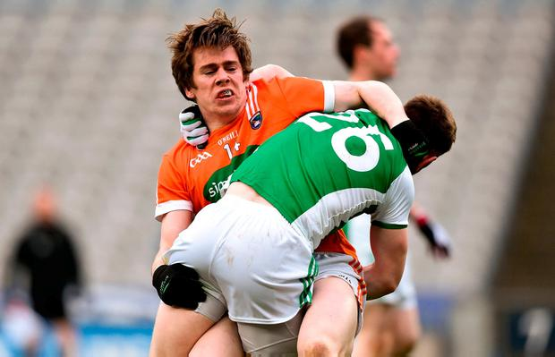 Andrew Murnin of Armagh tries to escape the clutches of Daniel Teague. Photo: David Fitzgerald/Sportsfile