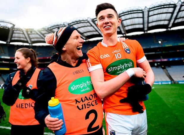Armagh selector Jim McCorry celebrates with Ben Crealey at the end of the game. Photo: David Fitzgerald/Sportsfile