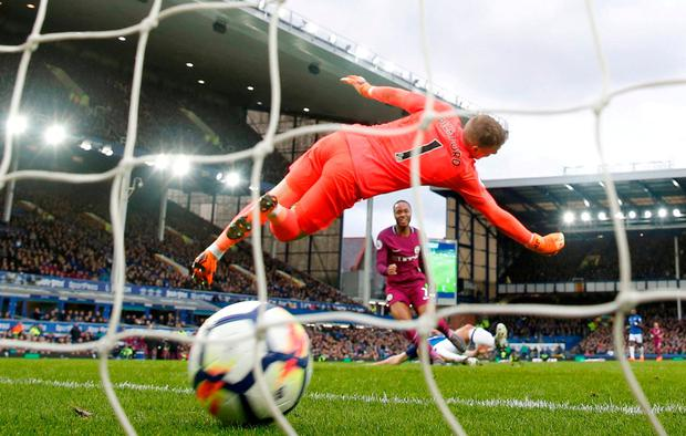 Manchester City's Raheem Sterling scores his side's third goal. Photo: Reuters