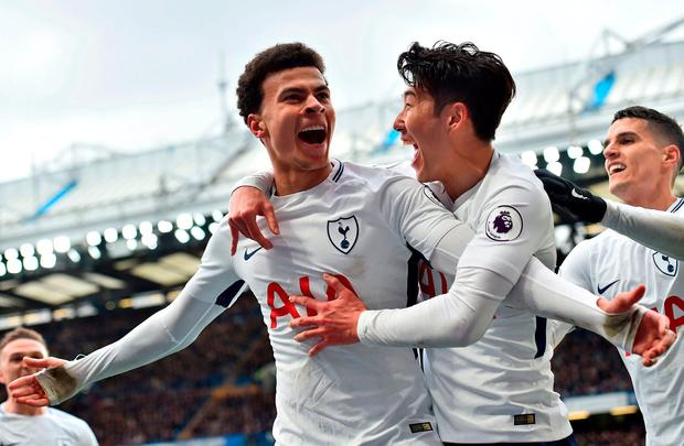 Dele Alli celebrates with Son Heung-Min after scoring Tottenham's second goal. Photo: Glyn Kirk/AFP/Getty Images