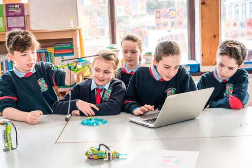 Fourth-class pupils (from left) Tommy Gallagher, Madeleine Walsh, Elaina Molloy, and Kate Melody (all 10) and Cian Feeney (12), in sixth class, are given an opportunity to be creative with Lego robots at Attymass National School, Co Mayo. Photo: Keith Heneghan