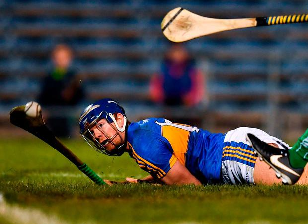 Despite falling to the ground, Jason Forde scoops home Tipperary's second goal during their NHL Division 1 semi-final with Limerick. Photo: Stephen McCarthy/Sportsfile