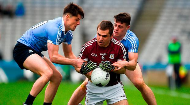 Dublin's ever-improving Eric Lowndes and last year's U-21 winner Brian Howard in action against Galway's Cathal Sweeney in the Allianz NFL Division 1 final. Photo: Daire Brennan/Sportsfile