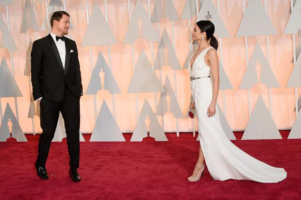 Channing Tatum (L) and Jenna Dewan Tatum attend the 87th Annual Academy Awards at Hollywood & Highland Center on February 22, 2015 in Hollywood, California. (Photo by Jason Merritt/Getty Images)