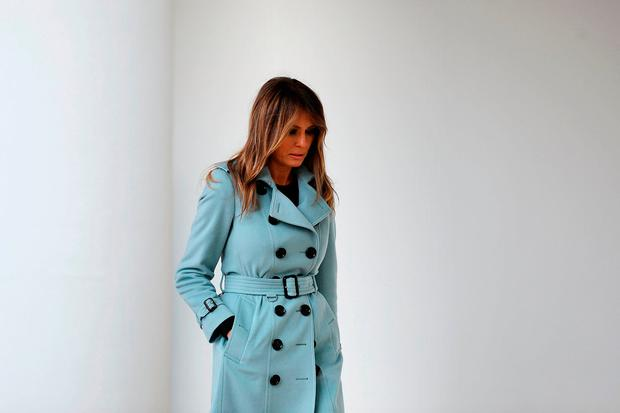 U.S. first lady Melania Trump heads back into the White House after hosting the 140th annual Easter Egg Roll on the South Lawn April 2, 2018 in Washington, DC