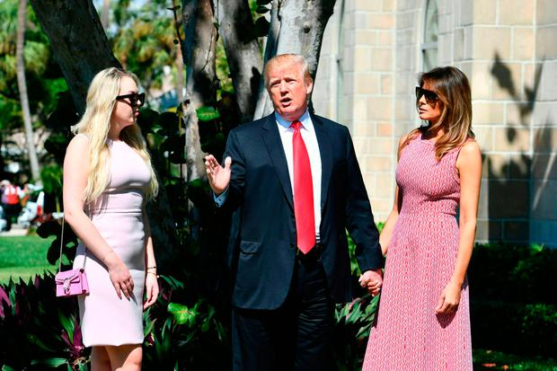 US President Donald Trump (C) with First Lady Melania Trump (R) and daughter Tiffany Trump (L) arrives for Easter service at the Church of Bethesda-by-the-Sea in Palm Beach, Florida, April 1, 2018. / AFP PHOTO / Nicholas KammNICHOLAS KAMM/AFP/Getty Images