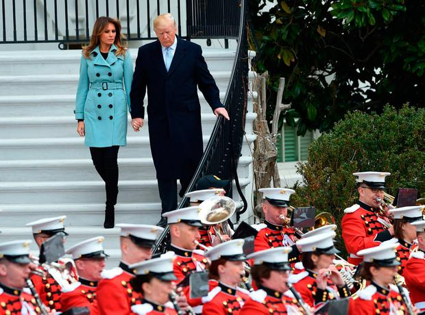 US President Donald Trump and First Lady Melania Trump walk down the stairs to greet members of the crowd during Easter celebrations at the White House in Washington, DC, on April 2, 2018. / AFP PHOTO / ANDREW CABALLERO-REYNOLDSANDREW CABALLERO-REYNOLDS/AFP/Getty Images