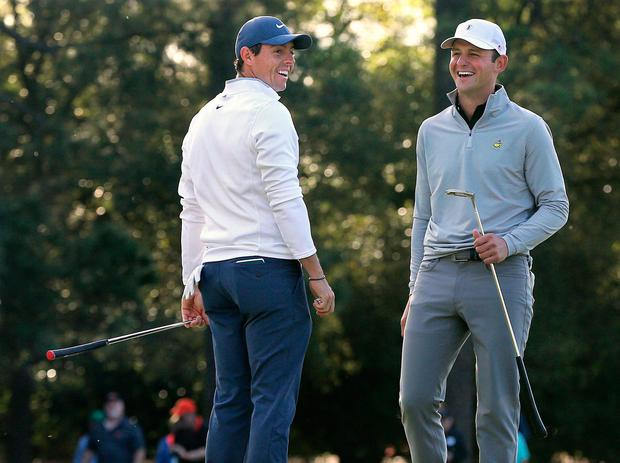 Rory McIlroy shares a laugh with Matt Parziale, right, the U.S. Mid-Amateur champion, at Augusta