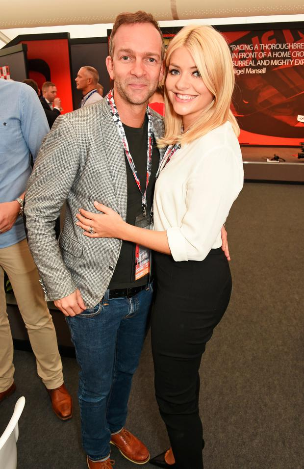 Dan Baldwin (L) and Holly Willoughby attend the British Grand Prix in the Driver Lounge at Silverstone on July 10, 2016 in Northampton, England. (Photo by David M. Benett/Dave Benett/Getty Images)