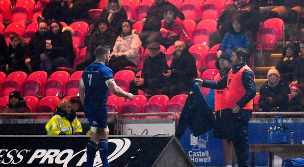 Seán OBrien of Leinster leaves the pitch with an injury during the first half of the Guinness PRO14 Round 17 match between Scarlets and Leinster at Parc Y Scarlets in Llanelli, Wales. Photo by Ramsey Cardy/Sportsfile