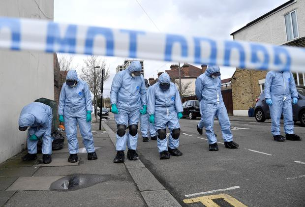 Forensic investigators examine the pavement and carriageway on Chalgrove Road, where a teenage girl was murdered, in Tottenham, Britain, April 3, 2018. REUTERS/Toby Melville