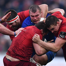 2CJ Stander, supported by Munster teammates Billy Holland, left, and Tommy ODonnell, right, is tackled by Jack McGrath of Leinster during the Guinness PRO14 Round 11 match between Munster and Leinster at Thomond Park last December