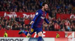 SEVILLE, SPAIN - MARCH 31: Lionel Messi of FC Barcelona celebrates after scoring the second goal of FC Barcelona during the La Liga match between Sevilla CF and FC Barcelona at Estadio Ramon Sanchez Pizjuan on March 31, 2018 in Seville, Spain. (Photo by Aitor Alcalde/Getty Images)