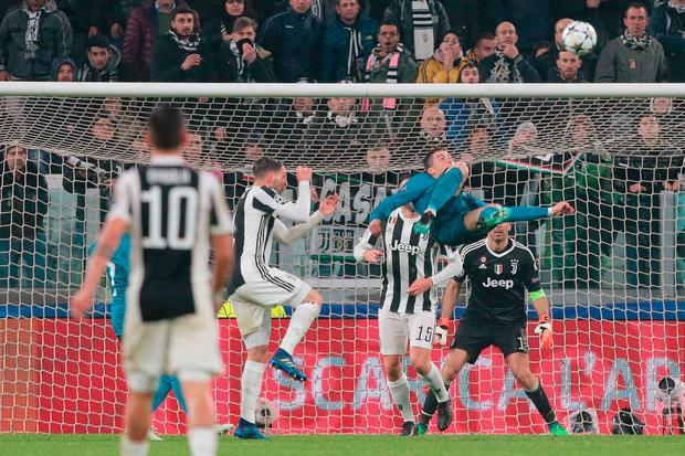 Cristiano Ronaldo overhead kicks Real Madrid into a two goal lead at the Allianz Stadium. Photo: Emilio Andreoli/Getty Images