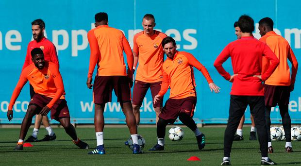 Barcelona's Lionel Messi and teammates pictured during squad training. Photo: REUTERS/Albert Gea