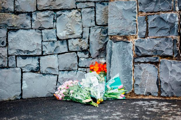 Floral tributes left at scene. Photo: Brian Arthur