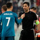 Juventus goalkeeper Gianluigi Buffon, right, shakes hands with Real Madrid's Cristiano Ronaldo