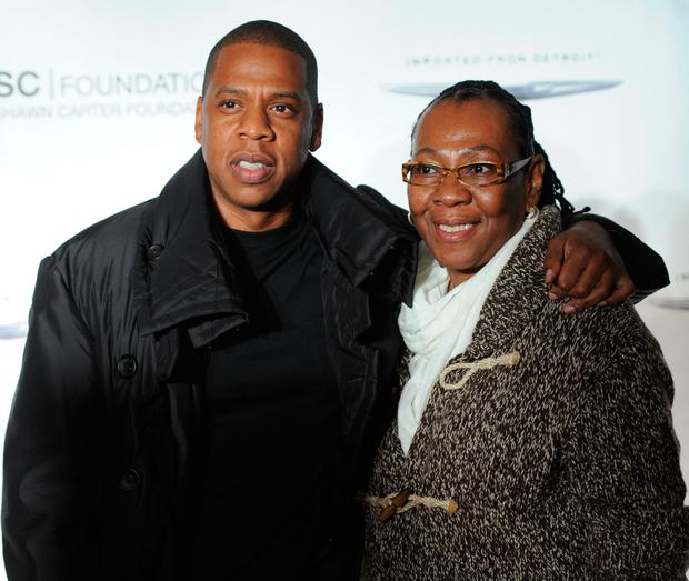 Jay-Z poses with his mother, Gloria Carter during an evening of
