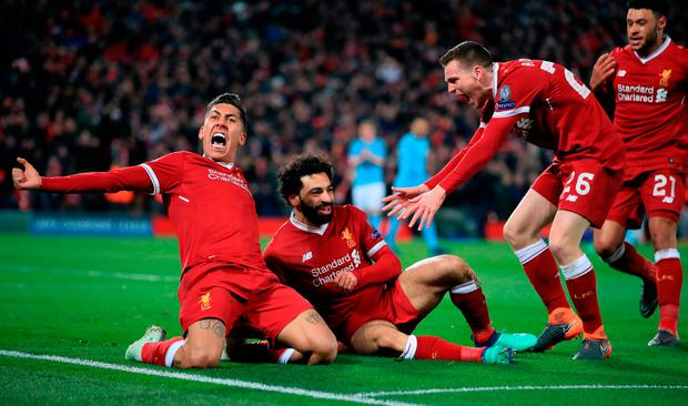 Liverpool's Mohamed Salah (centre) celebrates scoring his side's first goal of the game during the UEFA Champions League quarter final, first leg match at Anfield, Liverpool. Peter Byrne/PA Wire
