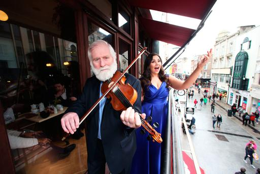 John Sheahan serenades the people of Dublin from the balcony of Bewley's Café on Grafton Street where he was joined by opera singer Rachel Croash. Photo: Leon Farrell
