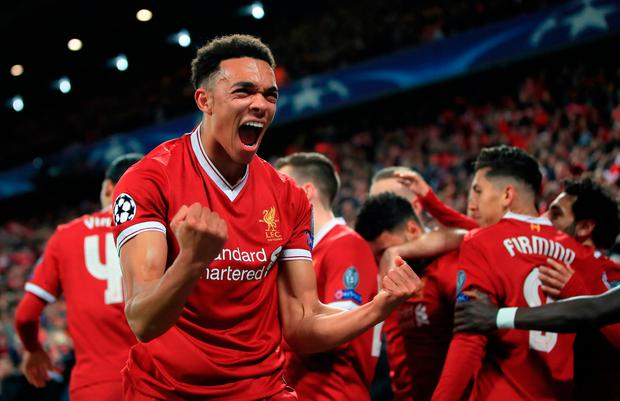 Liverpool's Trent Alexander-Arnold celebrates after Alex Oxlade-Chamberlain (background) scores his side's second goal of the game during the UEFA Champions League quarter final, first leg match at Anfield, Liverpool. Wednesday April 4, 2018. Peter Byrne/PA Wire