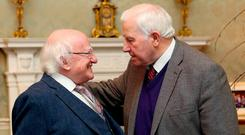 President Michael D Higgins and John Joyce, great grandson of John Joyce, who was murdered in 1882. Photo: Maxwells