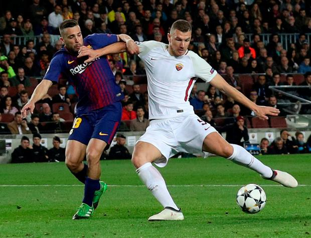Roma's Edin Dzeko scores their first goal. Photo: Albert Gea/Reuters
