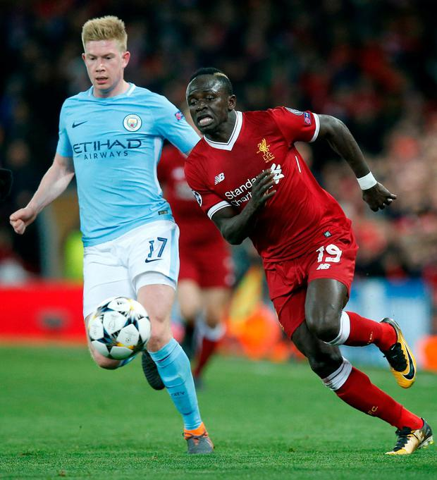 Liverpool's Sadio Mane in action with Manchester City's Kevin De Bruyne. Photo: Andrew Yates/Reuters