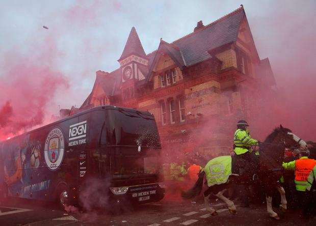 The team's bus comes under attack outside the stadium beforehand. Photo: Carl Recine/Action Images via Reuters