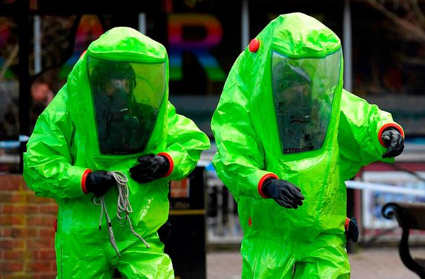 Officials in biohazard suits investigate the nerve agent attack in Salisbury, England. Photo: Ben Stansall/AFP/Getty Images