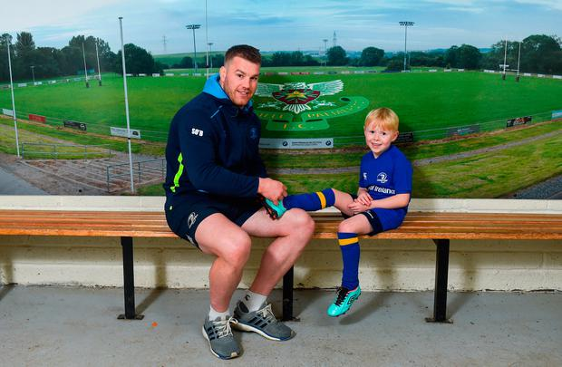 Seán O'Brien with six-year-old Andrew Olaf Bolton from De La Salle Palmerston RFC at the launch of the Bank of Ireland Leinster rugby summer camps david Fitzgerald/Sportsfile