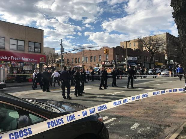 Police officers stand behind a cordon tape at the scene where New York police officers shot to death a black man who pointed a metal pipe at them, in the borough of Brooklyn, New York, U.S., April 4, 2018, in this picture obtained from social media. Instagram @johnnyg1rl/via REUTERS