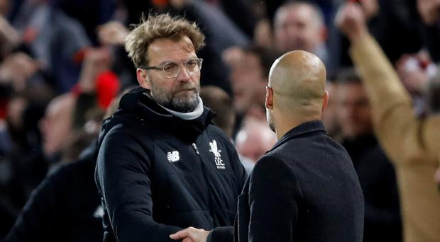 Liverpool manager Jurgen Klopp shakes hands with Manchester City manager Pep Guardiola after the match. Action Images via Reuters/Carl Recine