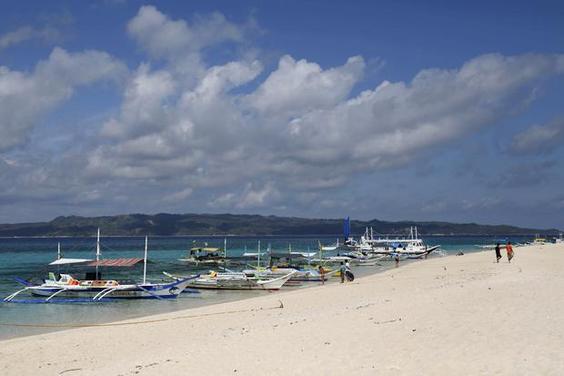 Traditional boats line up the shore in a secluded beach on the island of Boracay, central Philippines January 18, 2016. REUTERS/Charlie Saceda/File Photo