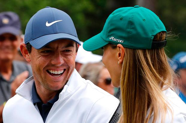 Rory McIlroy of Northern Ireland talks with his wife Erica Stoll. REUTERS/Mike Segar