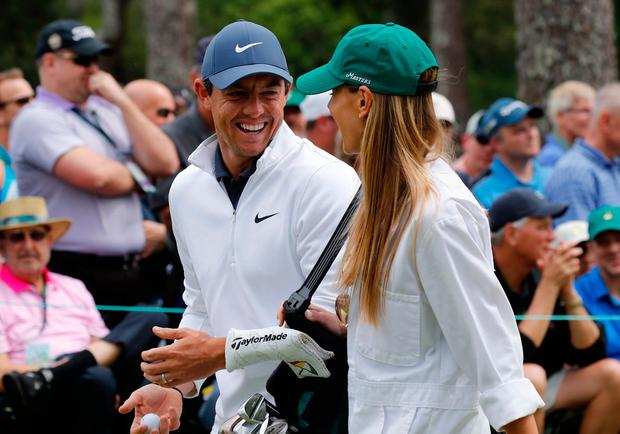 Rory McIlroy of Northern Ireland talks with his wife Erica Stoll during the par 3 contest held on the final day of practice for the 2018 Masters golf tournament at Augusta National Golf Club in Augusta, Georgia, U.S. April 4, 2018. REUTERS/Mike Segar