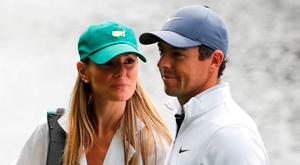 Rory McIlroy of Northern Ireland walks with his wife Erica Stoll during the par 3 contest held on the final day of practice for the 2018 Masters golf tournament at Augusta National Golf Club in Augusta, Georgia, U.S. April 4, 2018. REUTERS/Jonathan Ernst