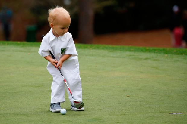 U.S. golfer Ryan Moore's son Tucker putts on the first green during the par 3 contest held on the final day of practice for the 2018 Masters golf tournament at Augusta National Golf Club in Augusta, Georgia, U.S. April 4, 2018. REUTERS/Mike Segar