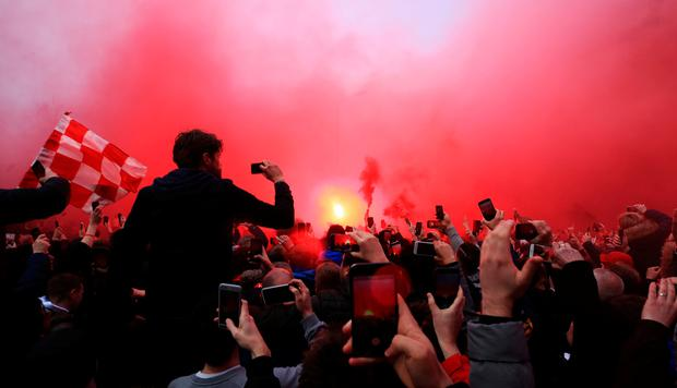 Fans let off flares as the teams arrive for the UEFA Champions League quarter final, first leg match at Anfield