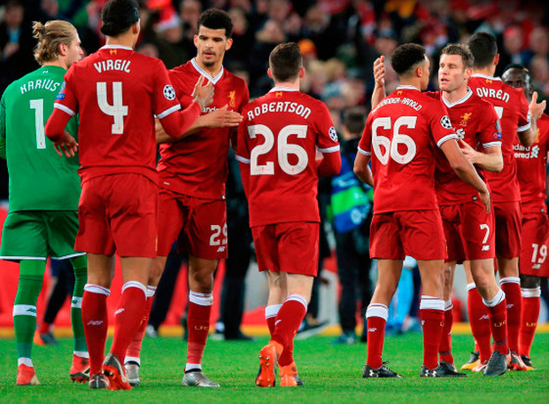 HALF-WAY THERE: Liverpool players celebrate their victory over Man City at Anfield on Wednesday night. Photo: PA