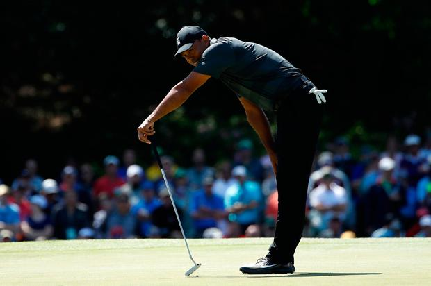 Tiger Woods of the U.S. reacts to a putt on the 15th green during first round play of the 2018 Masters golf tournament at the Augusta National Golf Club in Augusta, Georgia, U.S., April 5, 2018. REUTERS/Mike Segar