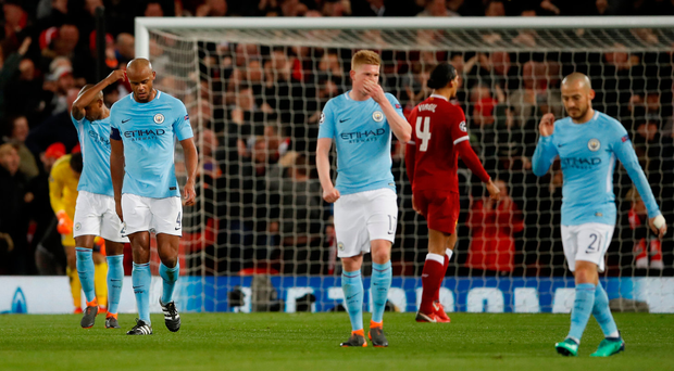 Manchester City's Vincent Kompany looks dejected after Liverpool's Sadio Mane scored their third goal. Photo: Reuters